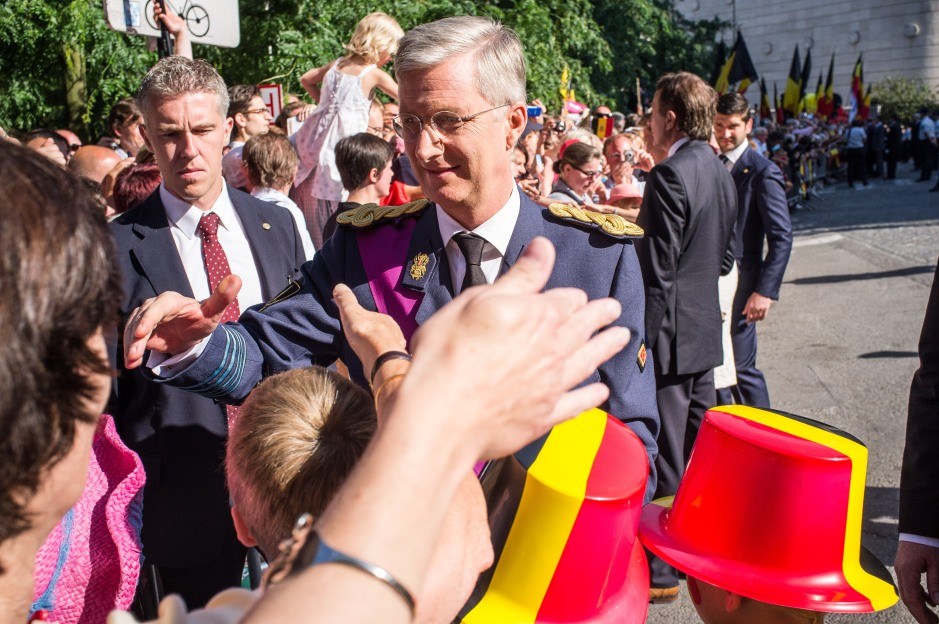 The new king of Belgium, king Filip, greets the crowd.